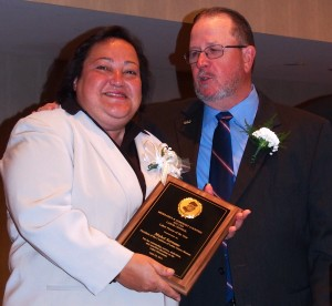 Mable Serrano receives Labor Person of the Year Award from Tom Tighe