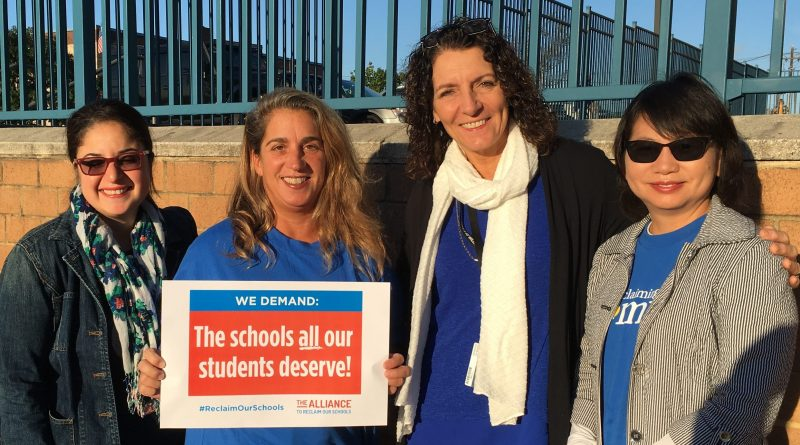 """Wilentz Elementary School teachers Engy Aly, Maria Hornlein, Debby Shepherd and Librarian Meina Montalbano participated in Thursday's """"Walk-In"""" to Reclaim Our Schools to call for funding for public education."""